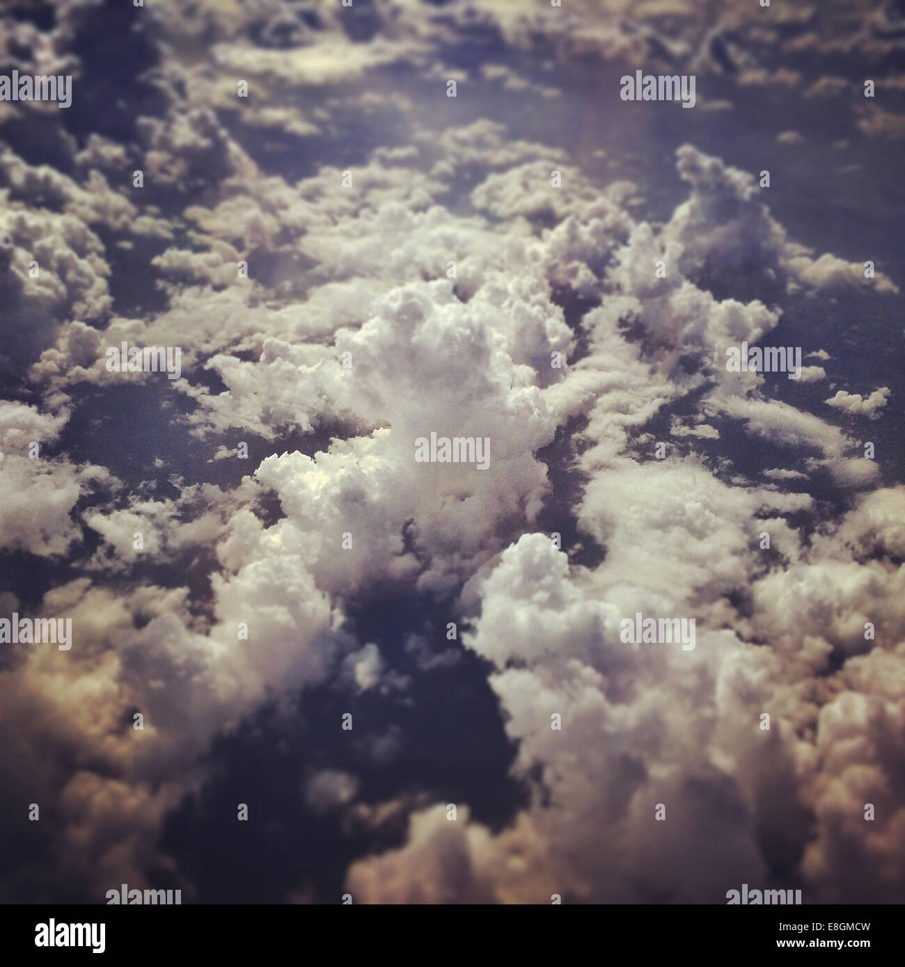 Cloudy sky from plane - Stock Image