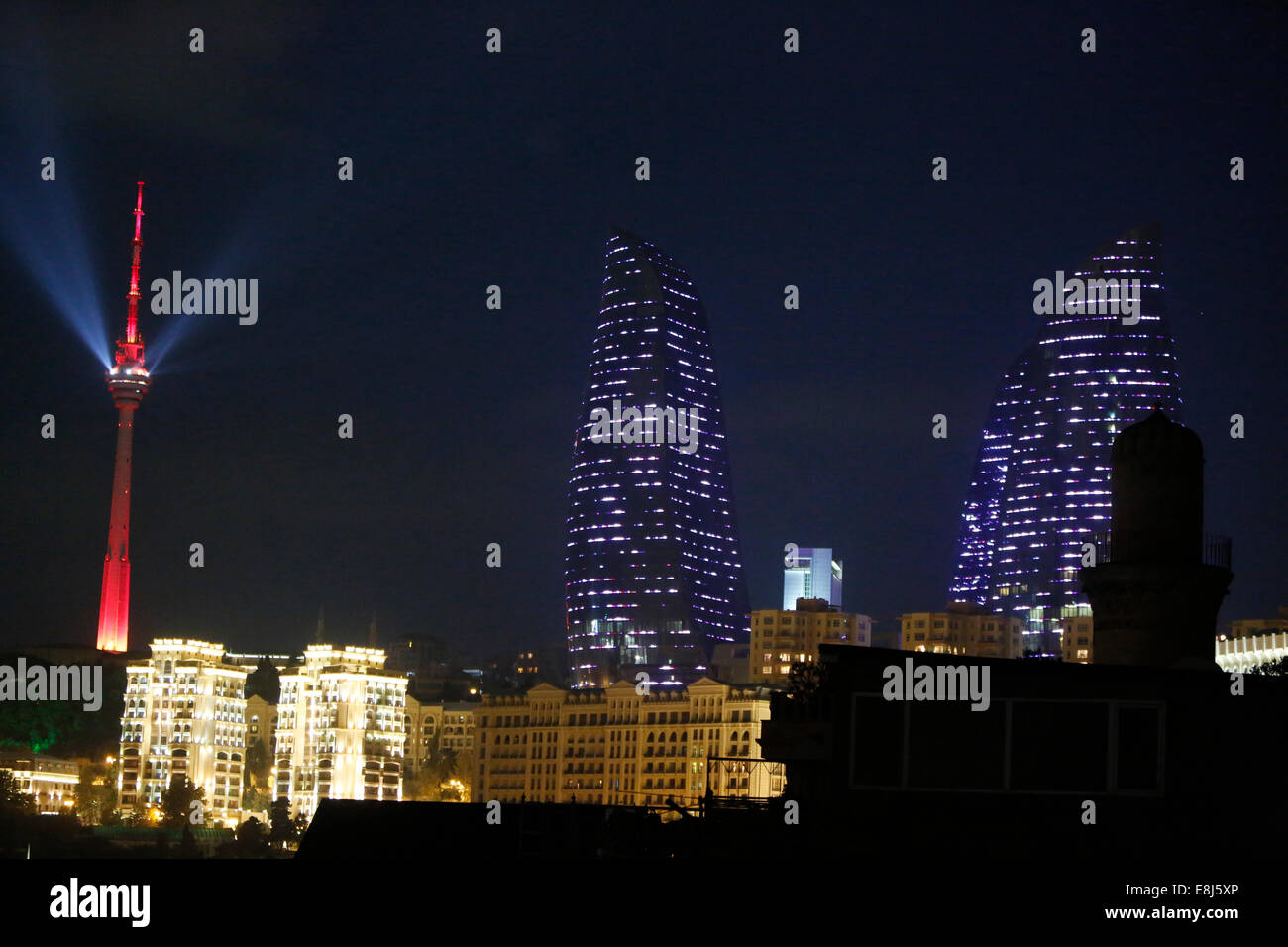 Flame Towers, a residential complex with a roof height of 190 m (620 ft) in Baku. The facades of the three Flame - Stock Image