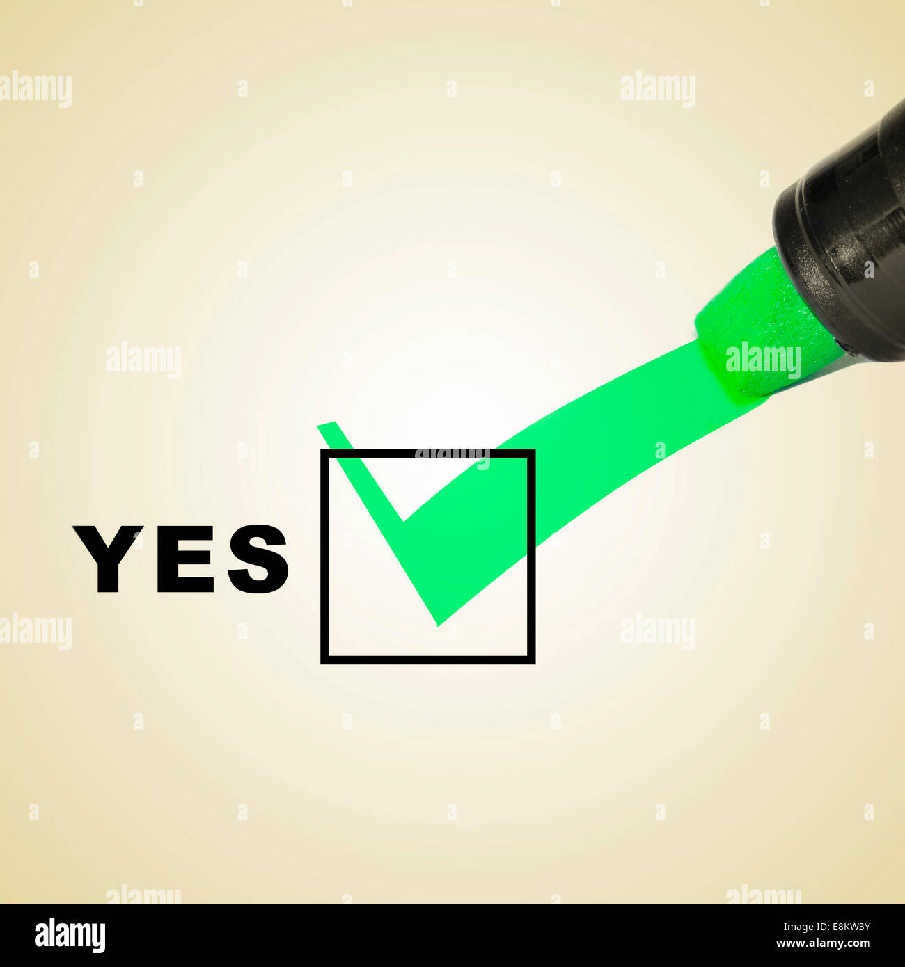 a check mark drawn with a green marker pen on a checbox with the word yes - Stock Image