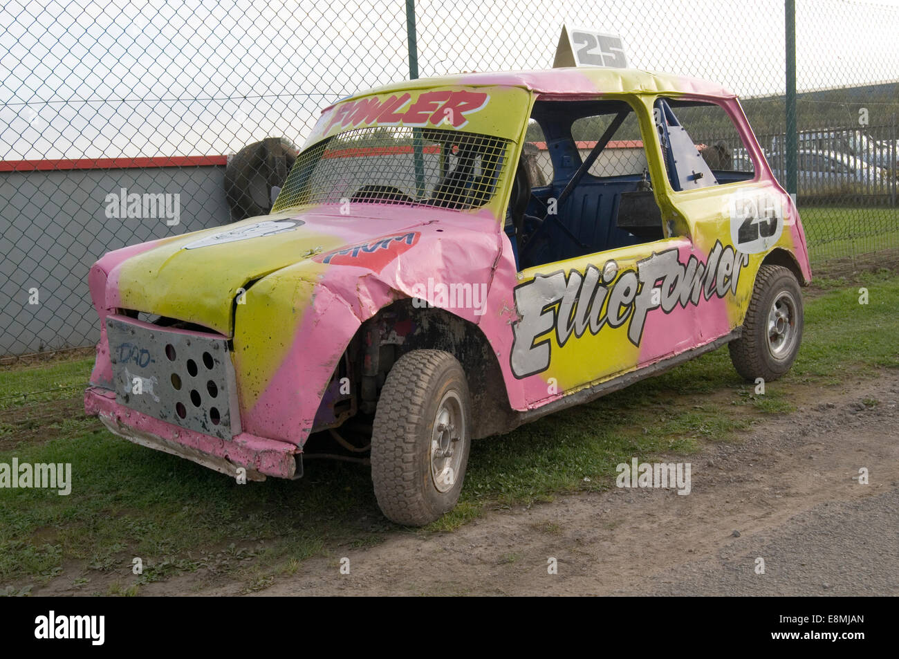 mini stock car cars minis grass track racing stockcar stockcars race races racing bl leyland bmc stripped out track - Stock Image
