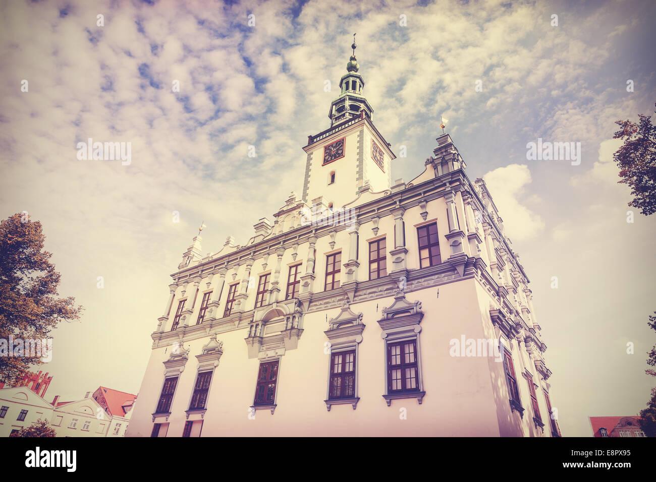 Vintage retro filtered photo of town hall in Chelmno, Poland. - Stock Image