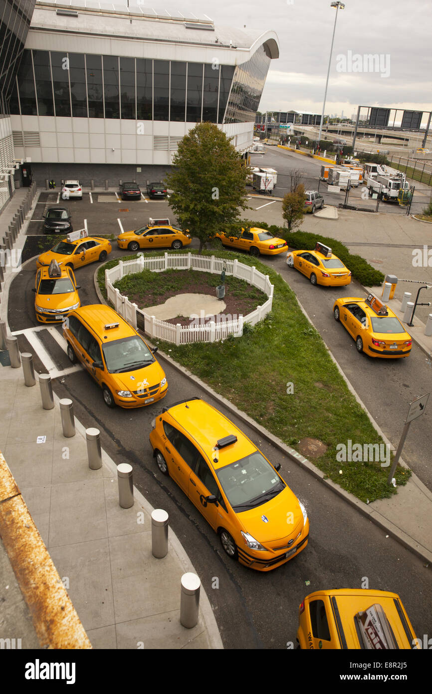 Taxi Cabs Line Up To Pick Up People At Jfk Airport In New York City