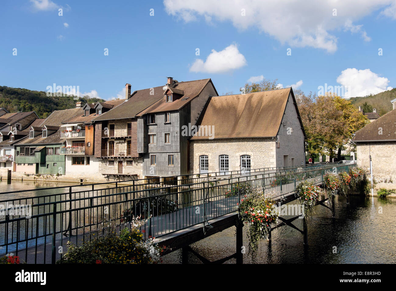 River Loue footbridge and quaint old houses in Ornans, Doubs, Franche Comte, France, Europe - Stock Image