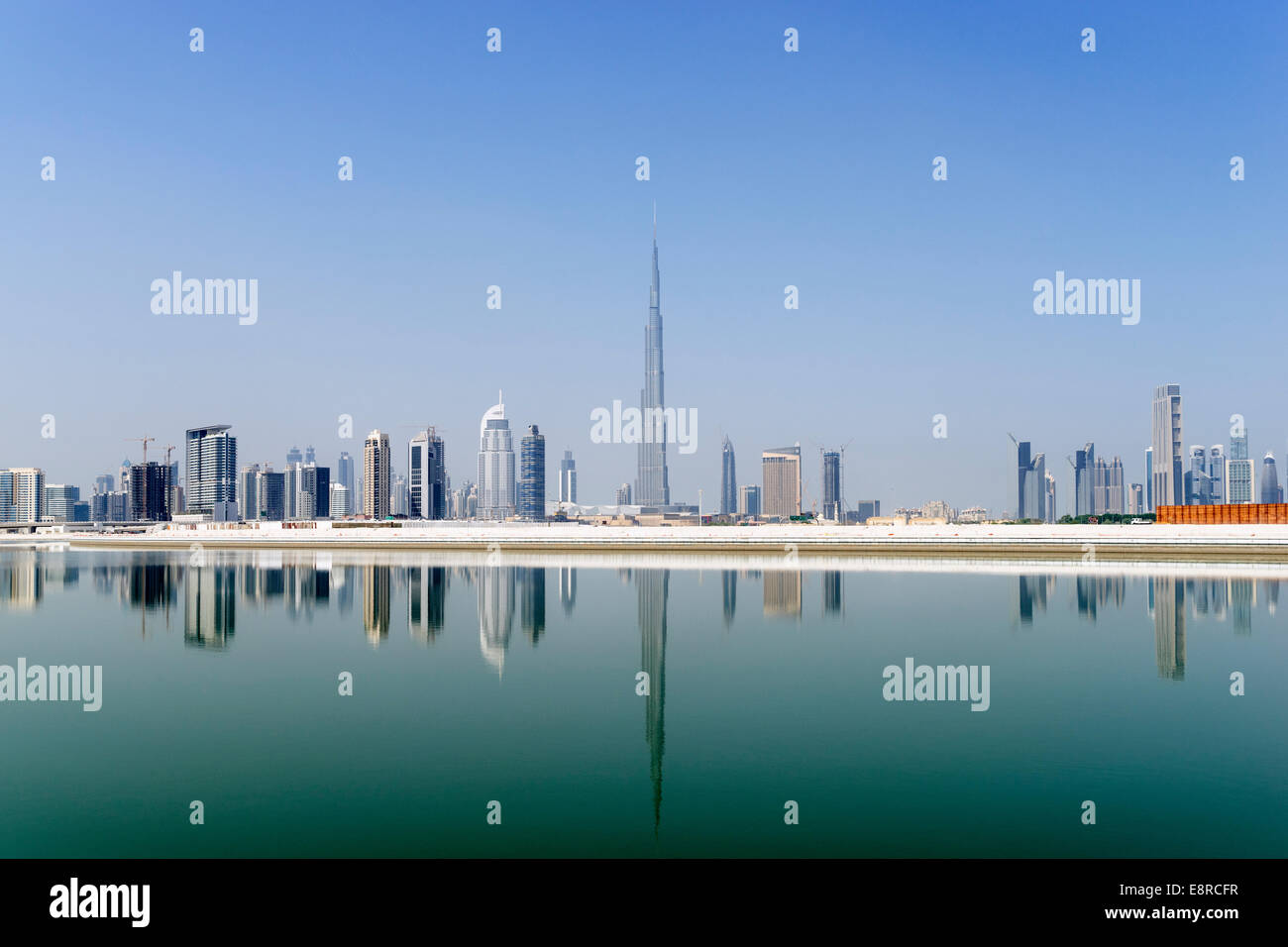 View across The Creek towards skyline of Dubai and Burj Khalifa at Business Bay in United Arab Emirates - Stock Image