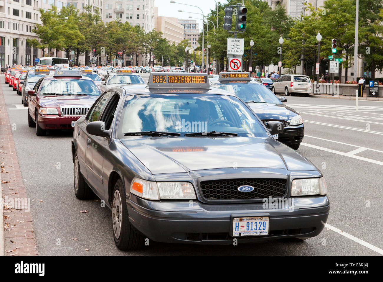 Taxis blocking traffic during taxi strike in front of District of Columbia City Hall - Washington, DC USA Stock Photo