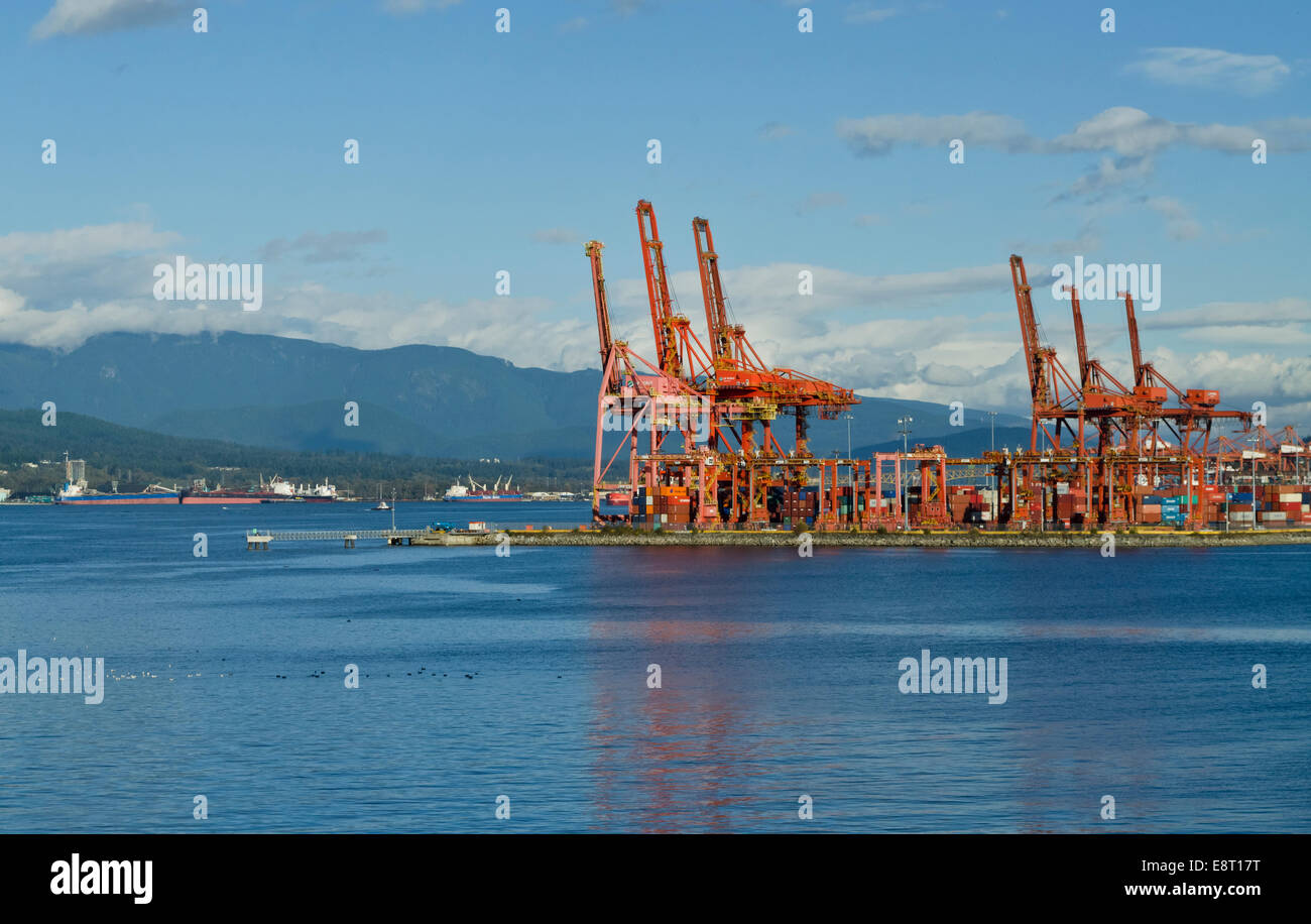 Loading cranes for container ships at the Port of Vancouver, on Burrard Inlet. Mountains. Container terminal Vancouver Stock Photo