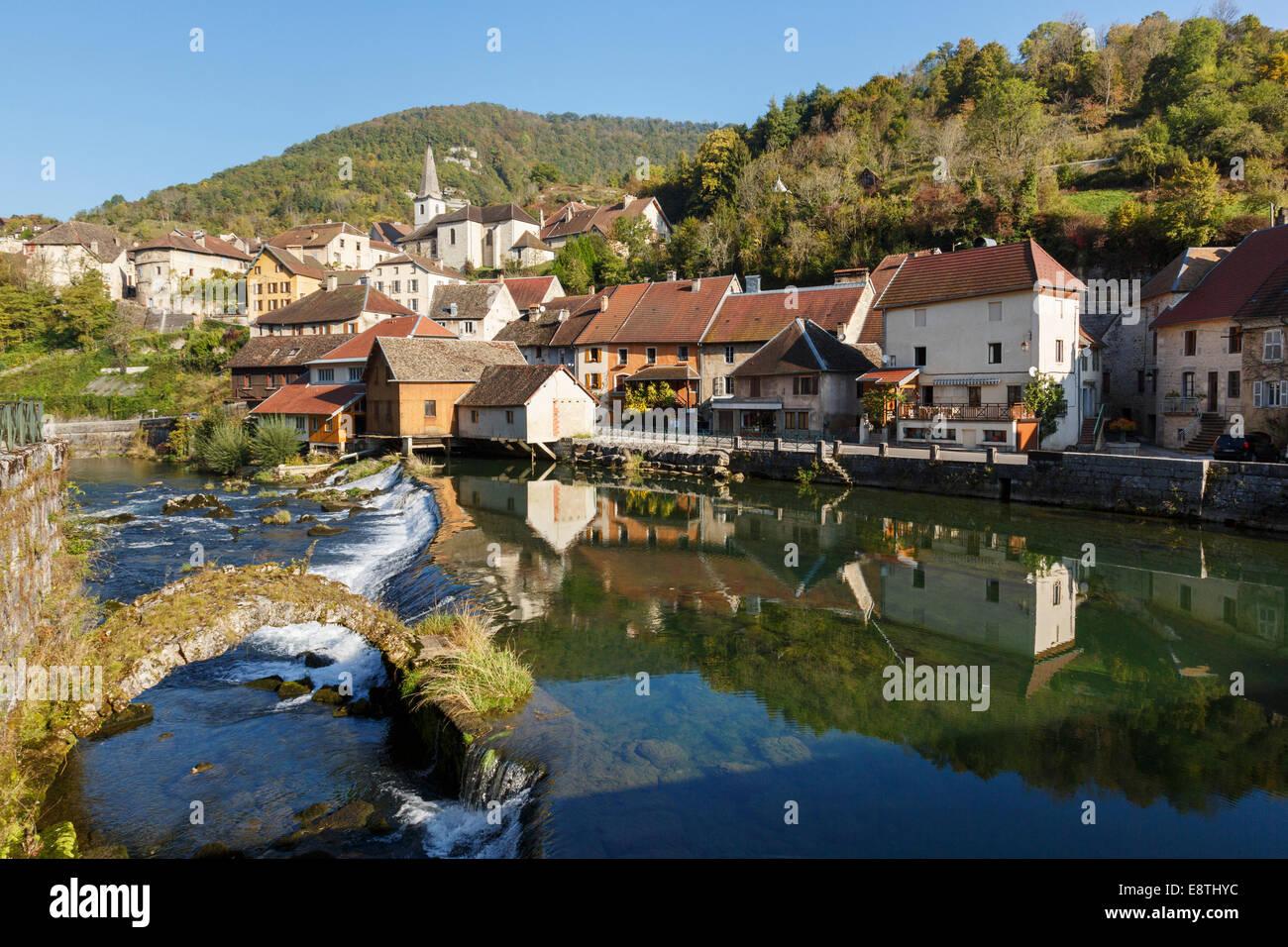 Landscape with River Loue and medieval bridge in picturesque village one of Les Plus Beaux Villages de France. Lods, - Stock Image