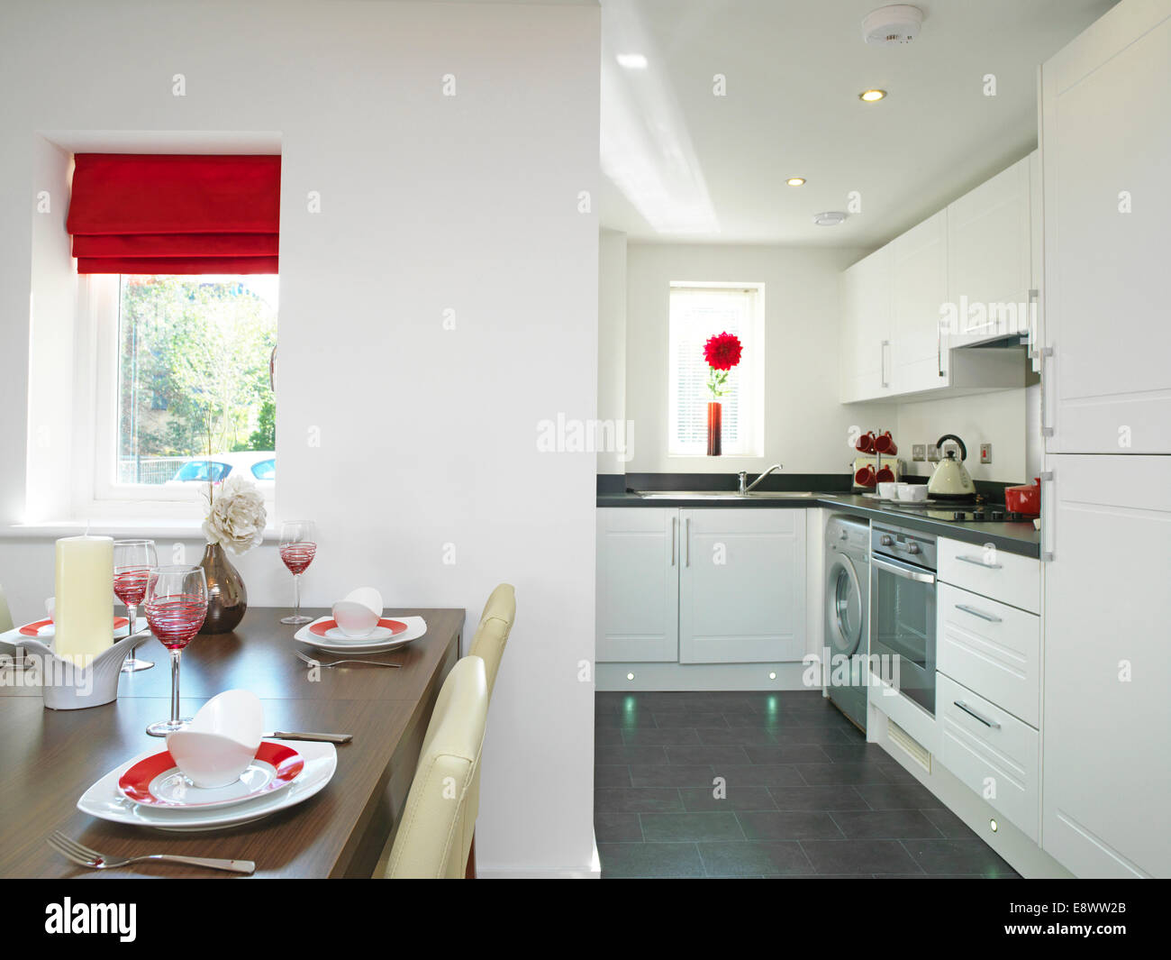 Open plan kitchen and dining room in show home, Kingston Mills Stock ...