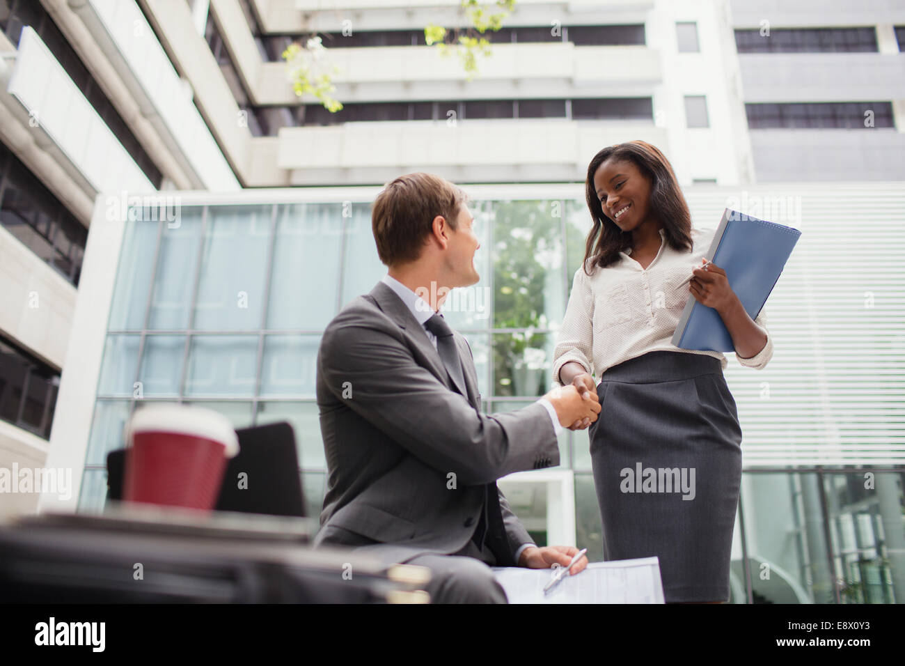 Business people talking outside of office building - Stock Image