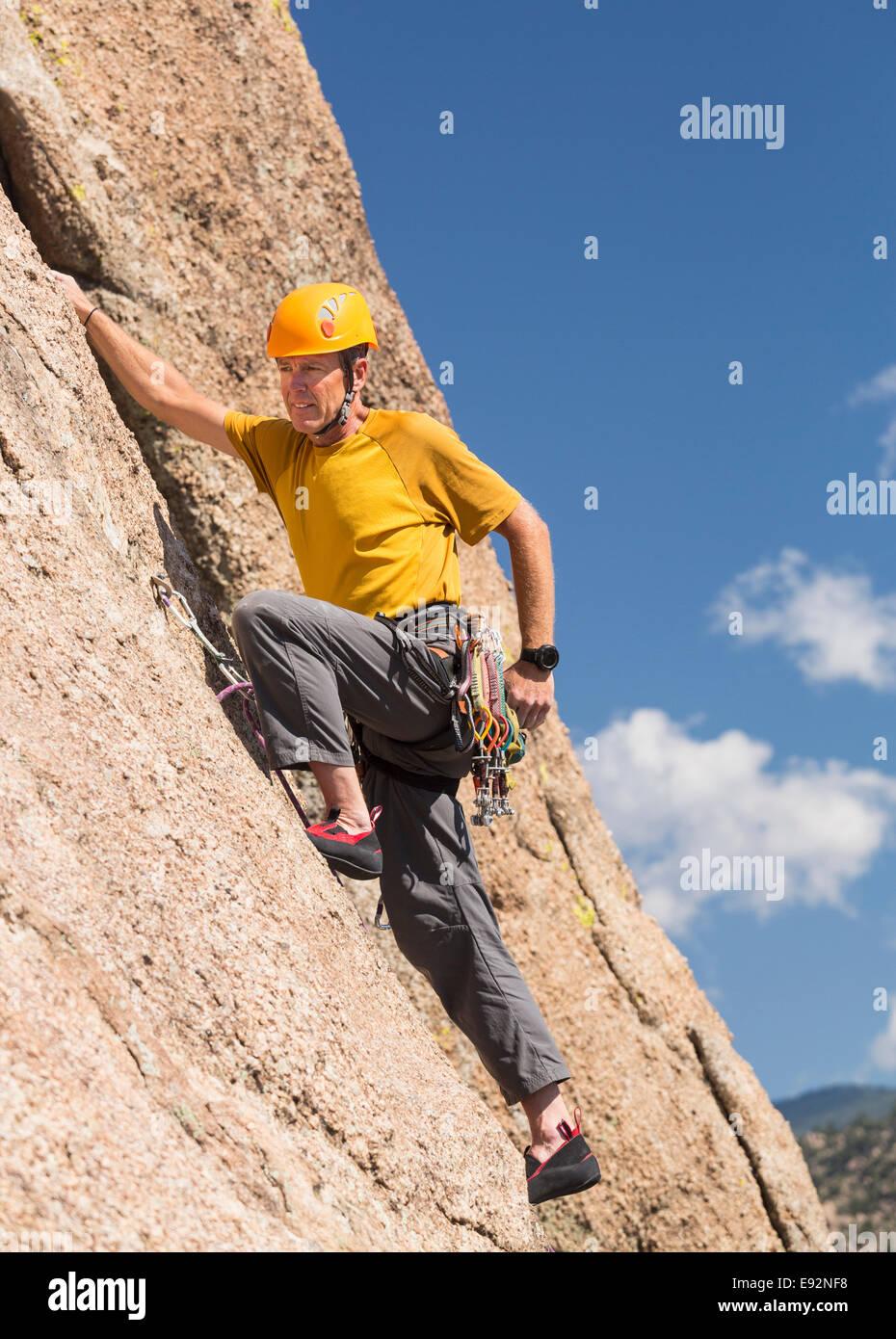 Senior male climber rock climbing on Turtle Rocks near Buena Vista, Colorado, USA - Stock Image