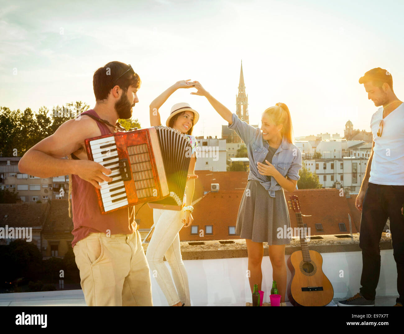 Young people having fun at rooftop party - Stock Image