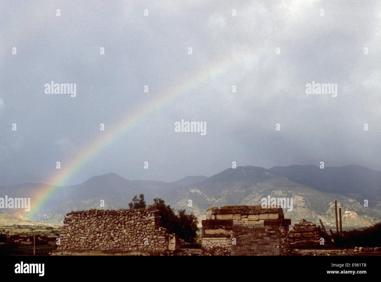 Rainbow over the Zapotec ruins of Mitla, Oaxaca, Mexico Stock Photo