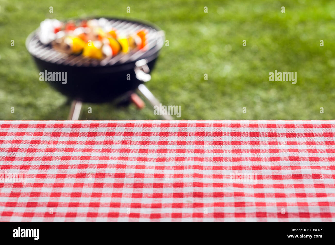 empty picnic table background covered in a fresh country red and