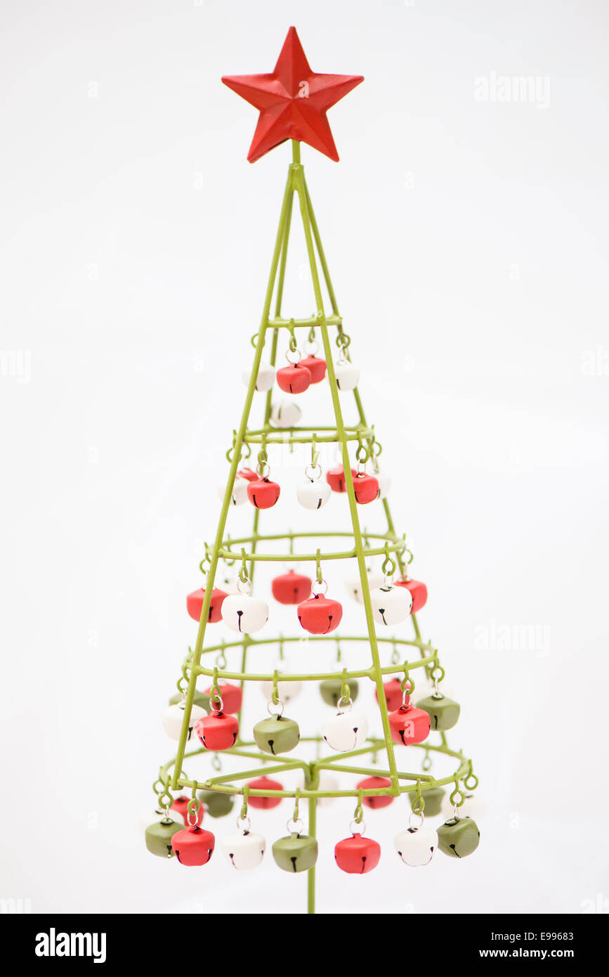 Contemporary metal Christmas tree with bells against a white Stock ...