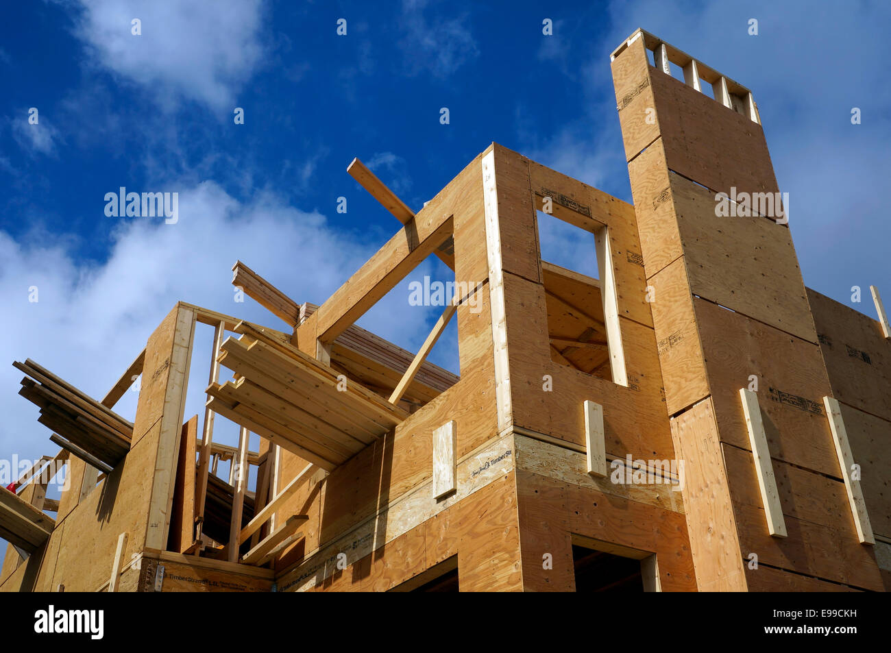 new-wood-frame-house-being-constructed-in-vancouver-bc-canada-E99CKH.jpg