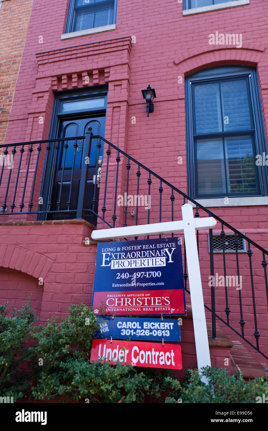 Long & Foster realtor sign on brick townhouse - Virginia USA - Stock Image