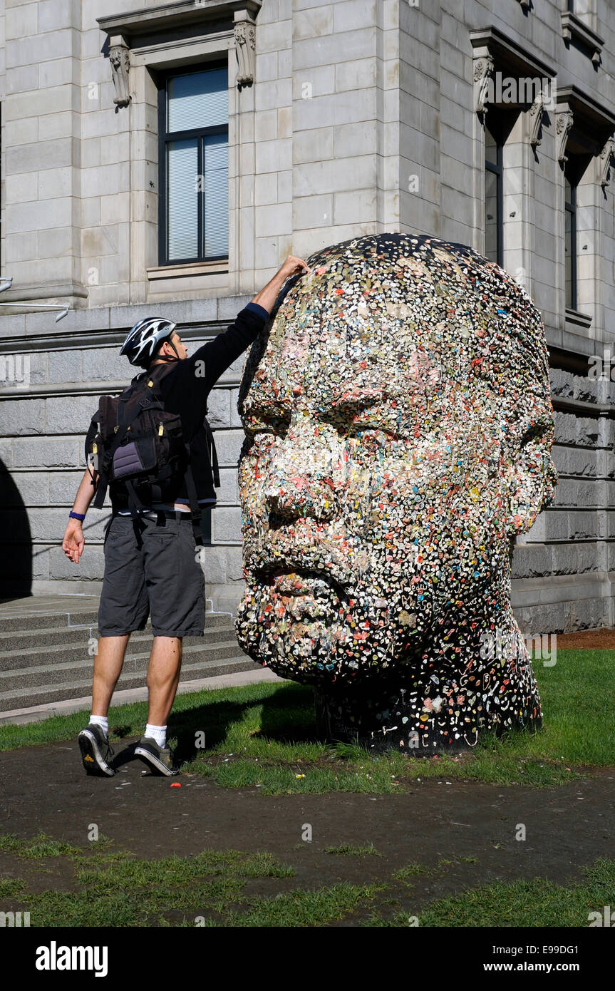 young-man-placing-chewing-gum-on-gumhead