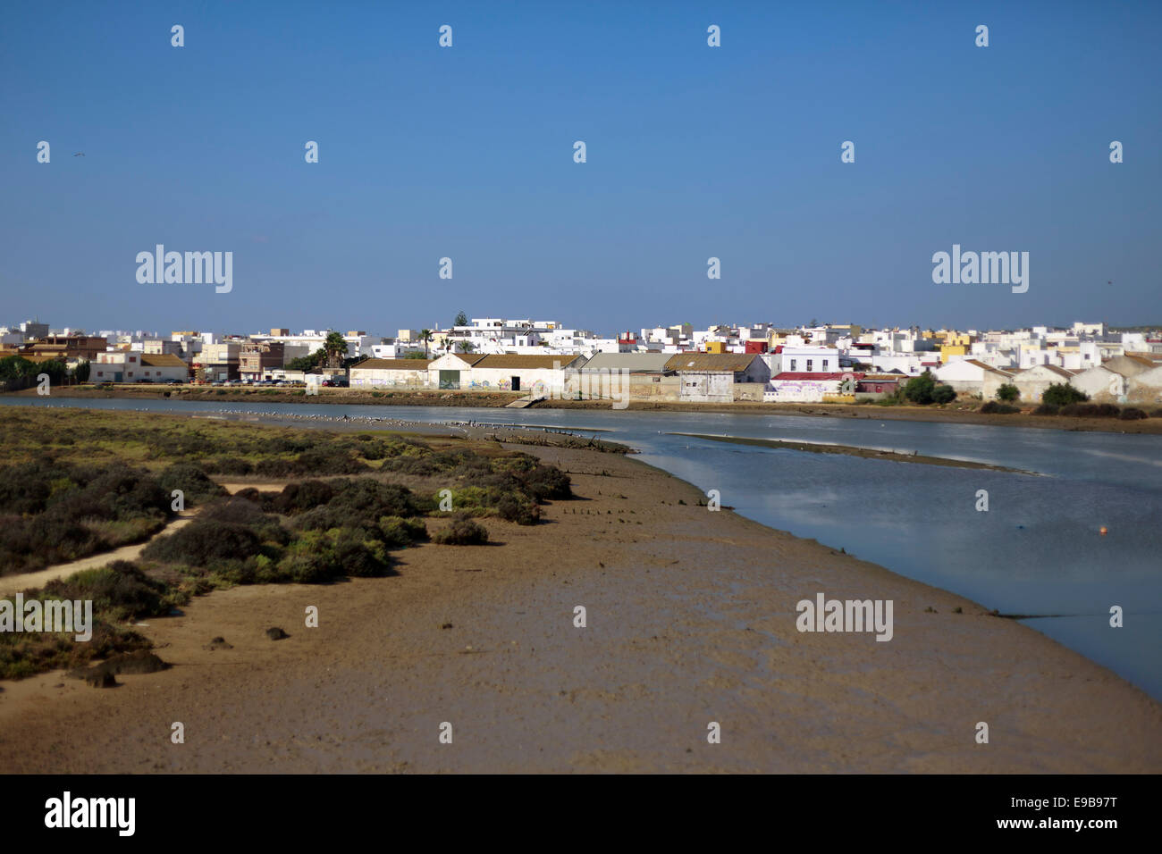 A general view of the marshland connecting to Spain Andalusia Barbate river next to the old harbor; at the end the - Stock Image