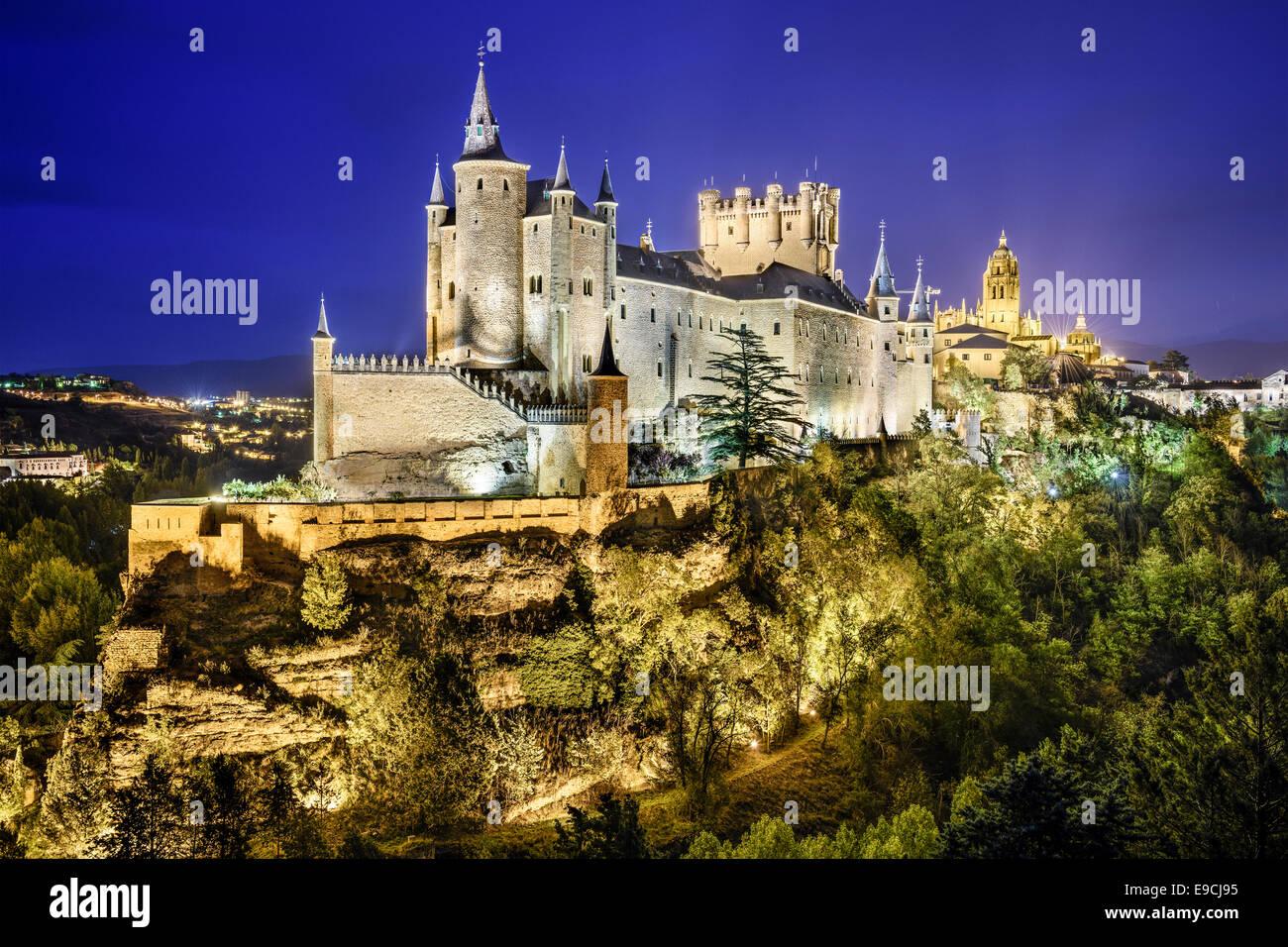 Segovia, Spain town skyline with the Alcazar at night. - Stock Image