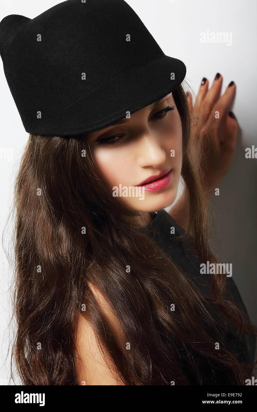 Vintage. Romantic Pensive Woman in Black Hat - Stock Image