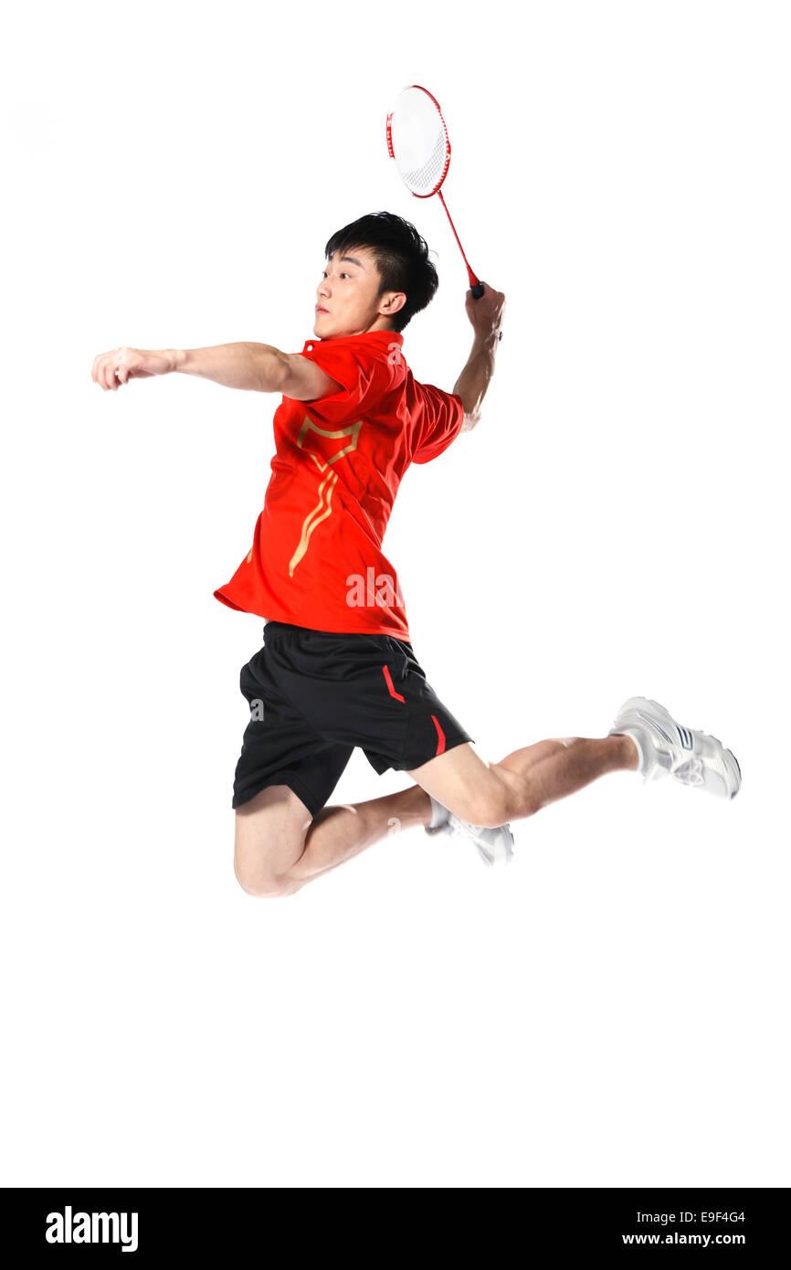 Male athletes playing badminton - Stock Image