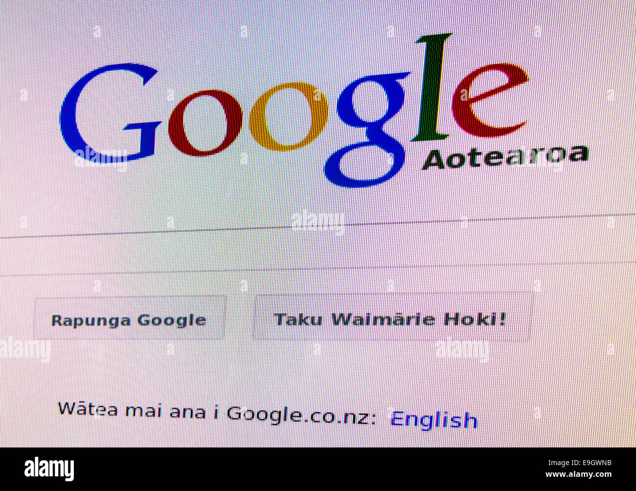 Google in Maori Language: Google Aotearoa. Google in Your Language initiative. Logo, search box on monitor screen Stock Photo