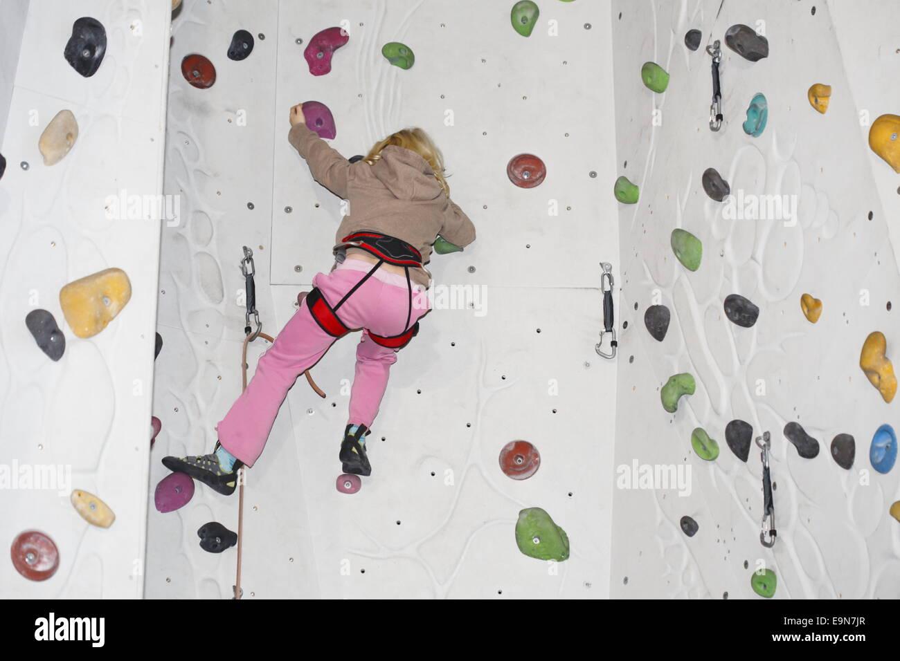 indoor climbing girl - Stock Image