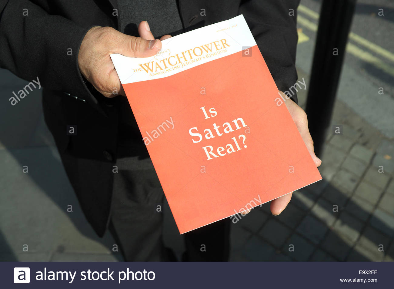 An edition of 'The Watchtower Announcing Jehovah's Kingdom' magazine , being handed out in the street in London, Stock Photo