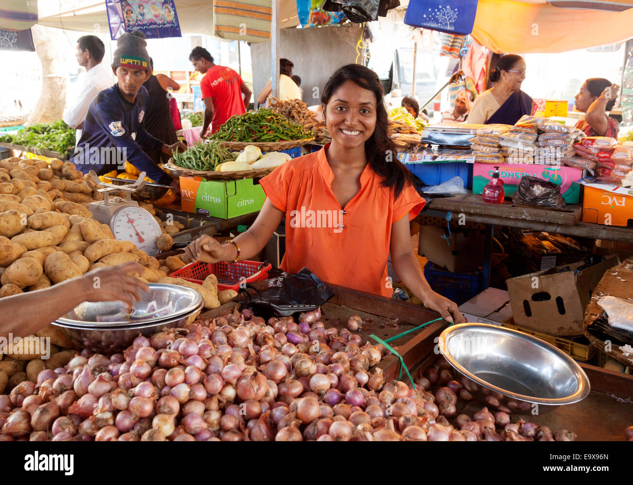 smiling-mauritius-woman-selling-food-at-her-stall-mahebourg-town-market-E9X96N.jpg
