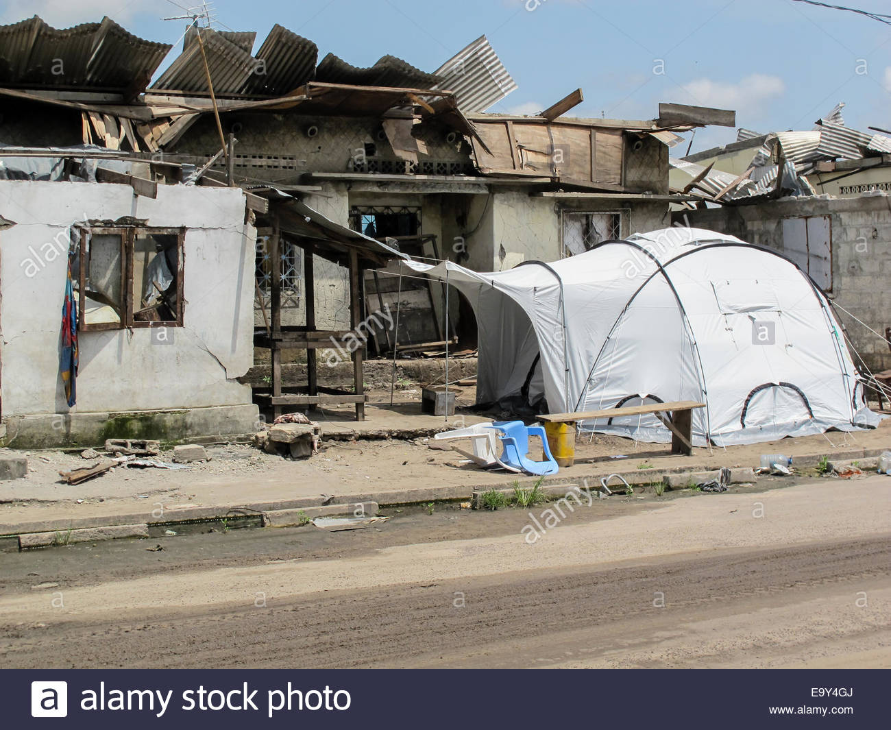 A disaster relief tent erected next to a badly damaged tent in Brazzaville. Congo  after an explosion made 14,000 - Stock Image