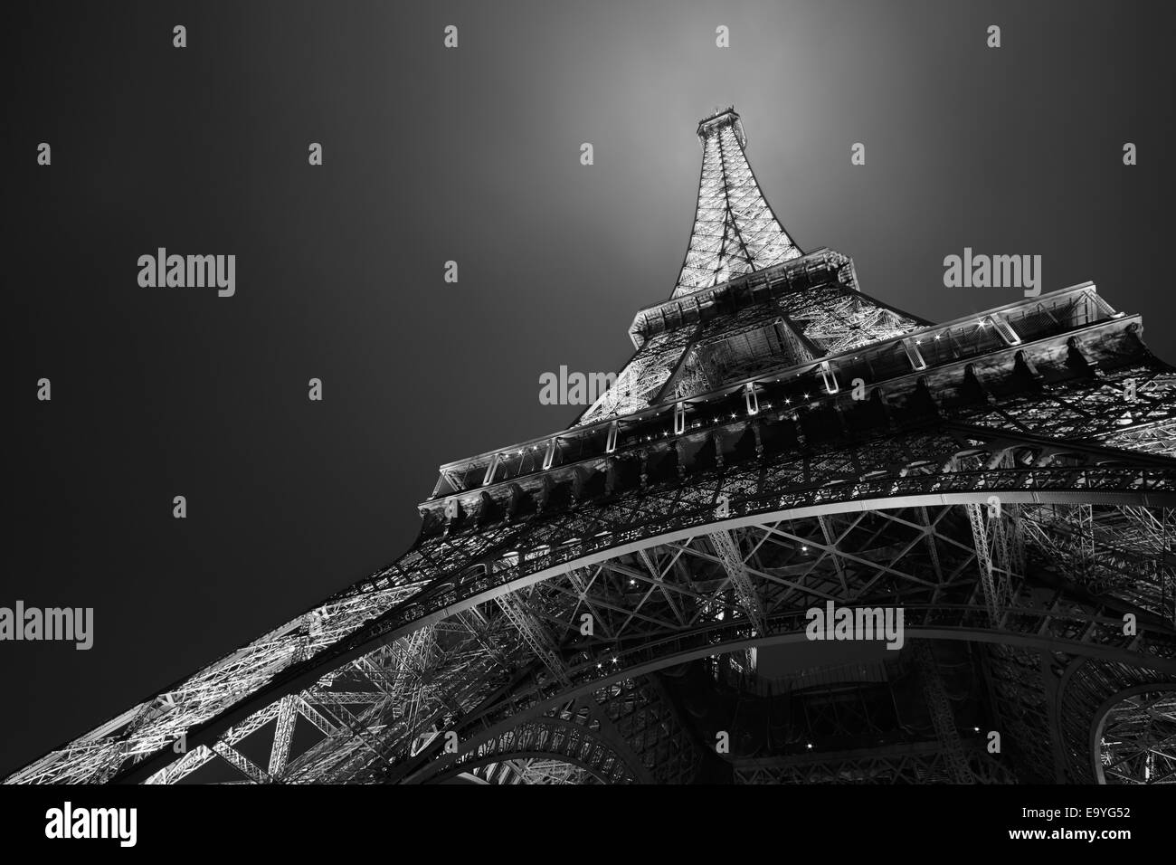 Eiffel tower in Paris at night, black and white, low angle view - Stock Image