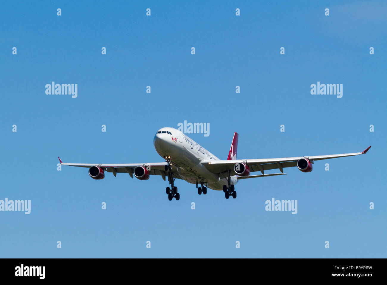 Virgin Atlantic Airbus A340-300, G-VELD, named African Queen, on its approach for landing at London Heathrow, England, - Stock Image