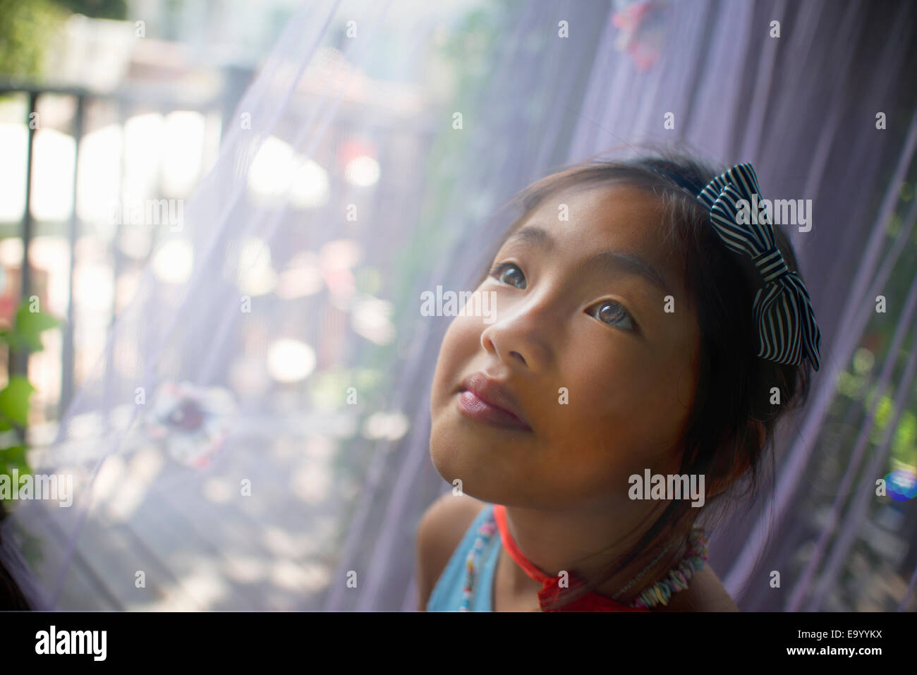 Portrait of young asian girl, head and shoulders, close-up - Stock Image