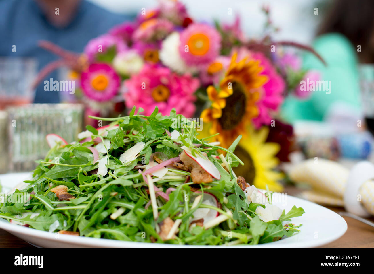 Fresh salad on serving plate, ready to be served - Stock Image