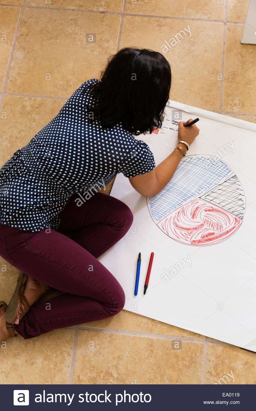 Woman drawing pie chart Small Business, Start-up - Stock Image