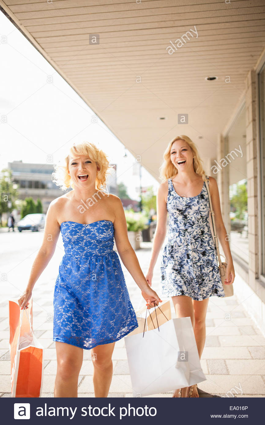 Sisters on shopping spree - Stock Image