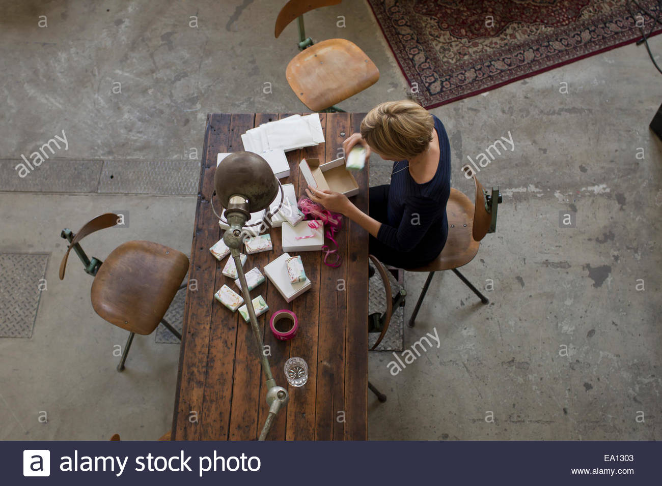 Mid adult woman working at table, high angle view - Stock Image