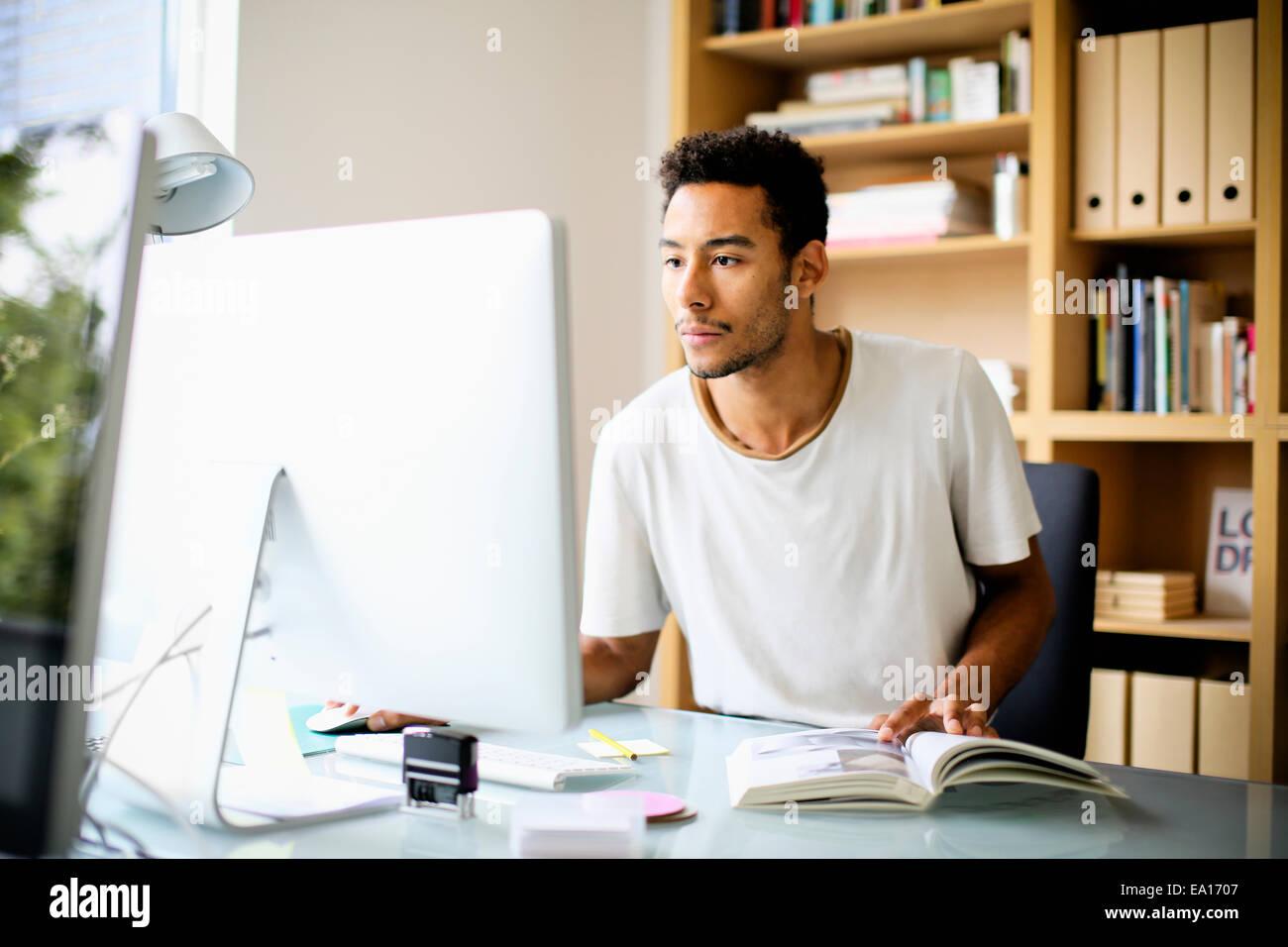 Graphic designer using computer at work - Stock Image