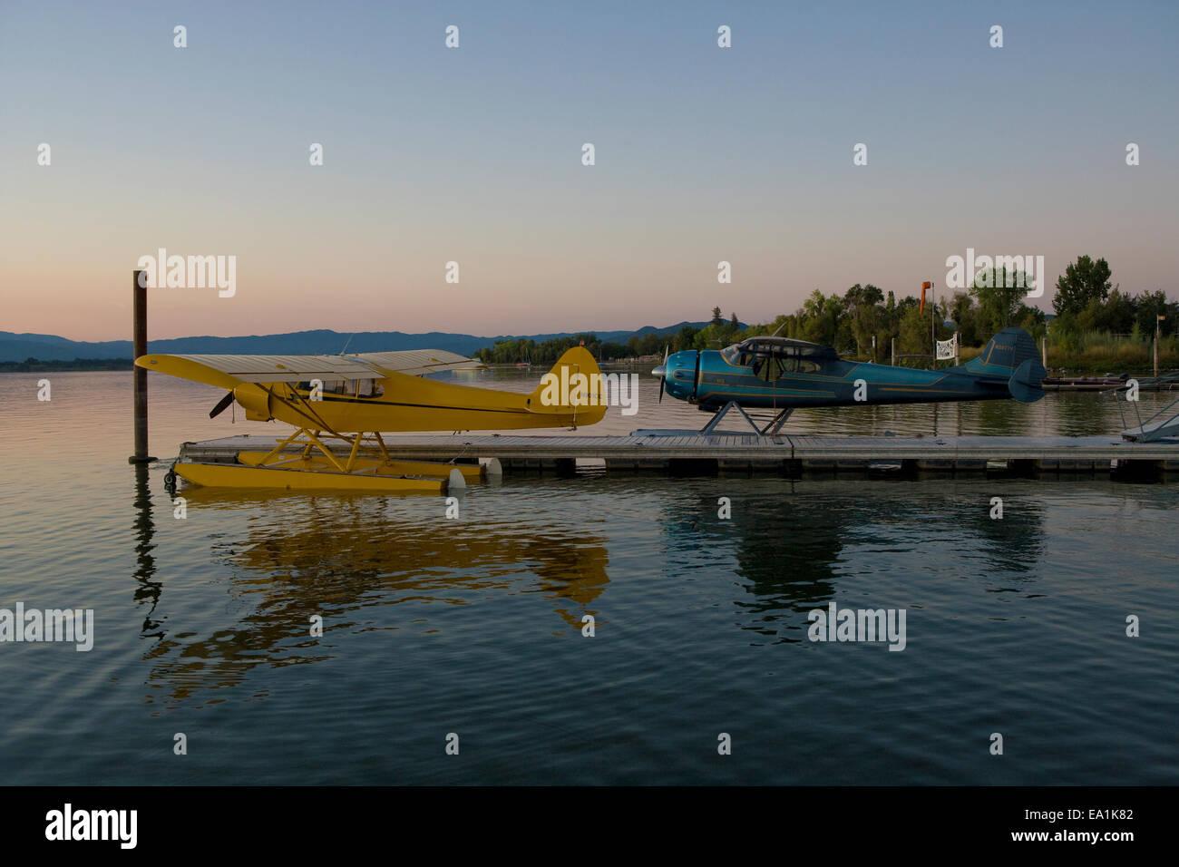 Cessna 195 and PiperSuper Cub docked at the Sky Lark Resort, Seaplane Splash-In, Lakeport, California, Lake County, - Stock Image