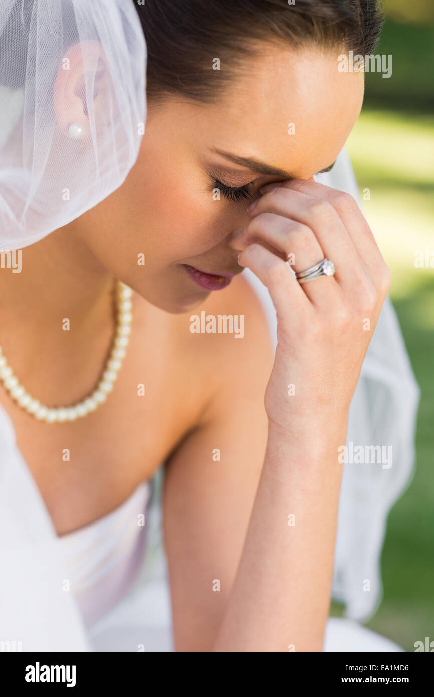 Beautiful worried bride at parkStock Photo