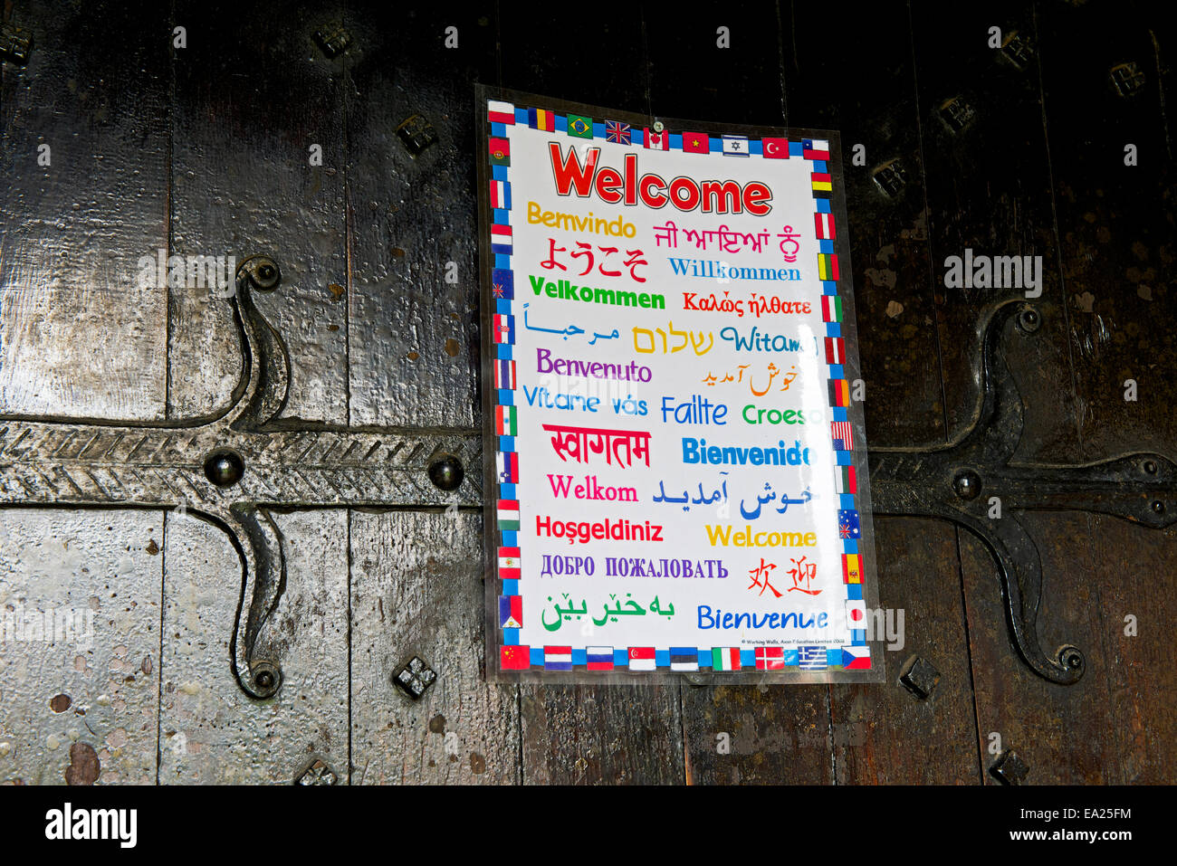 welcome-sign-in-many-languages-on-church-door-EA25FM.jpg