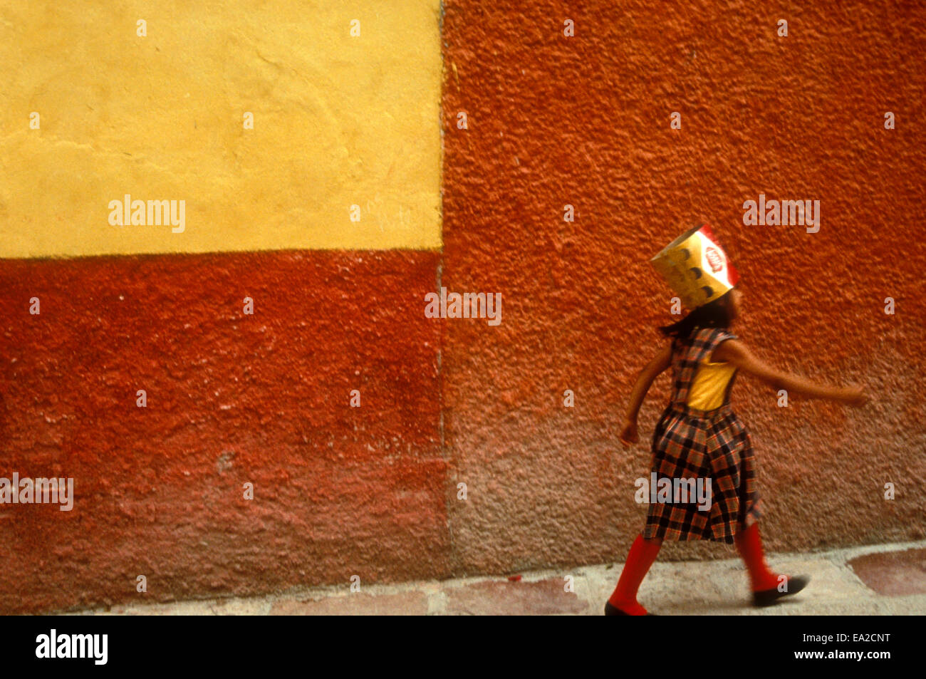 girl-wearing-a-party-hat-striding-down-a