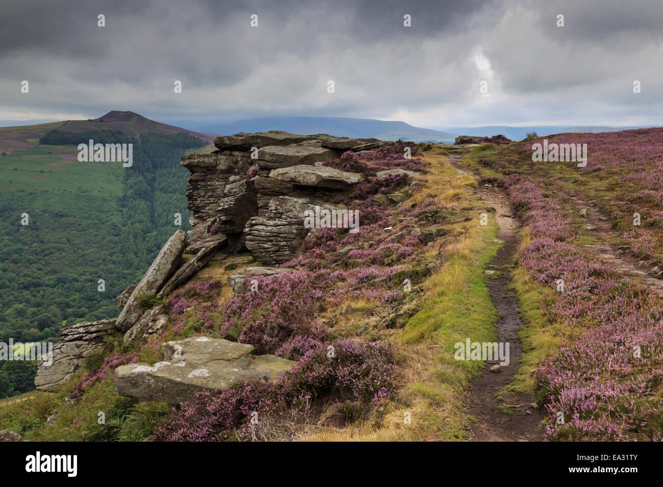 Track on Bamford Edge, Win Hill and a distant Kinder Plateau, Dark Peak, Peak District, Derbyshire, England, United - Stock Image