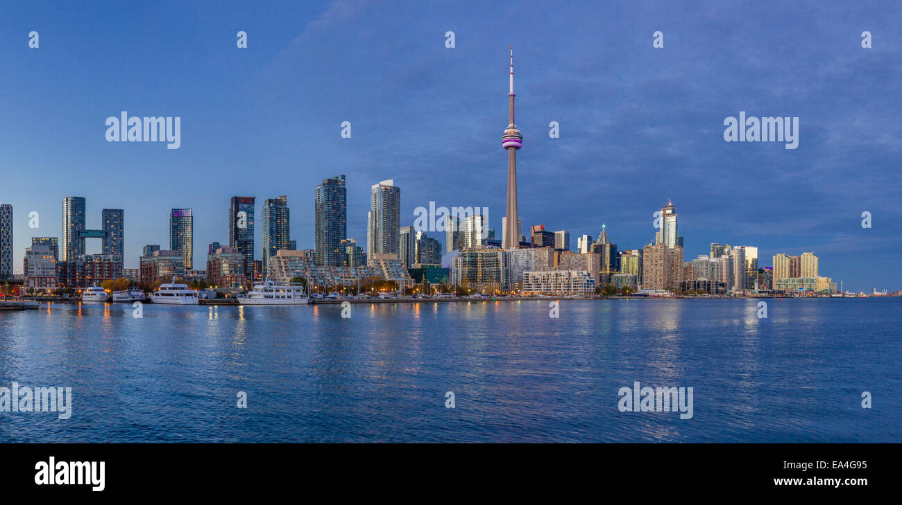 Toronto cityscape from the islands at dusk. - Stock Image