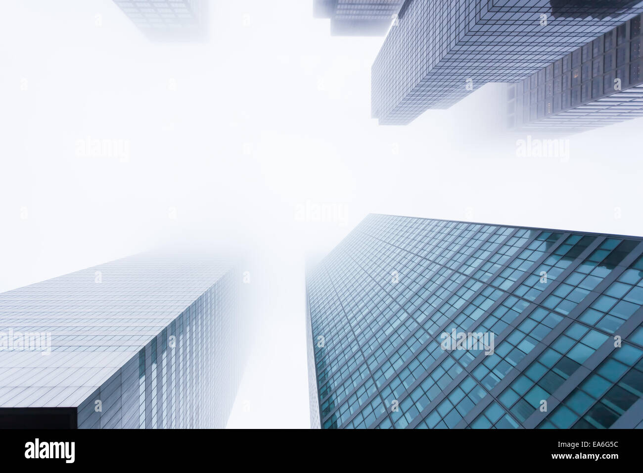 USA, New York State, New York City, Manhattan, View of skyscrapers in mist - Stock Image