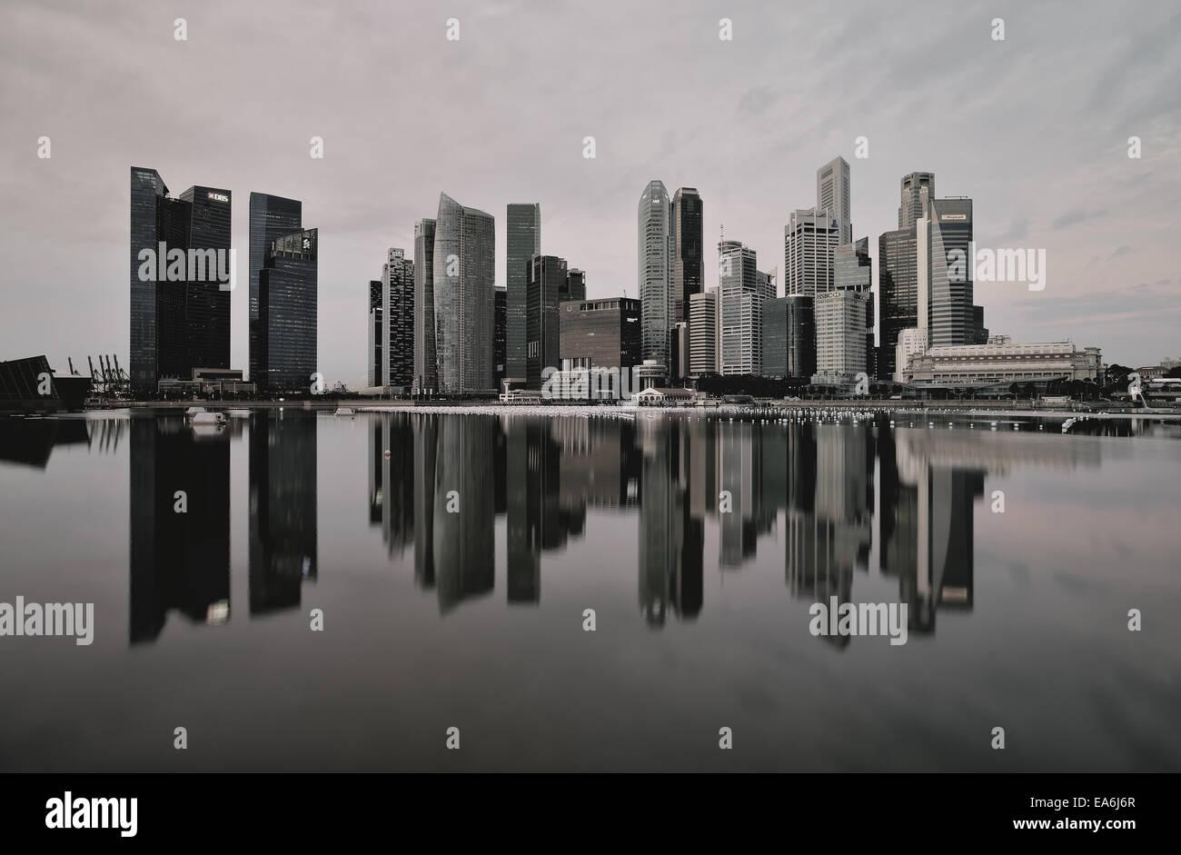 Singapore, Business district taken from Marina Bay waterfront promenade - Stock Image