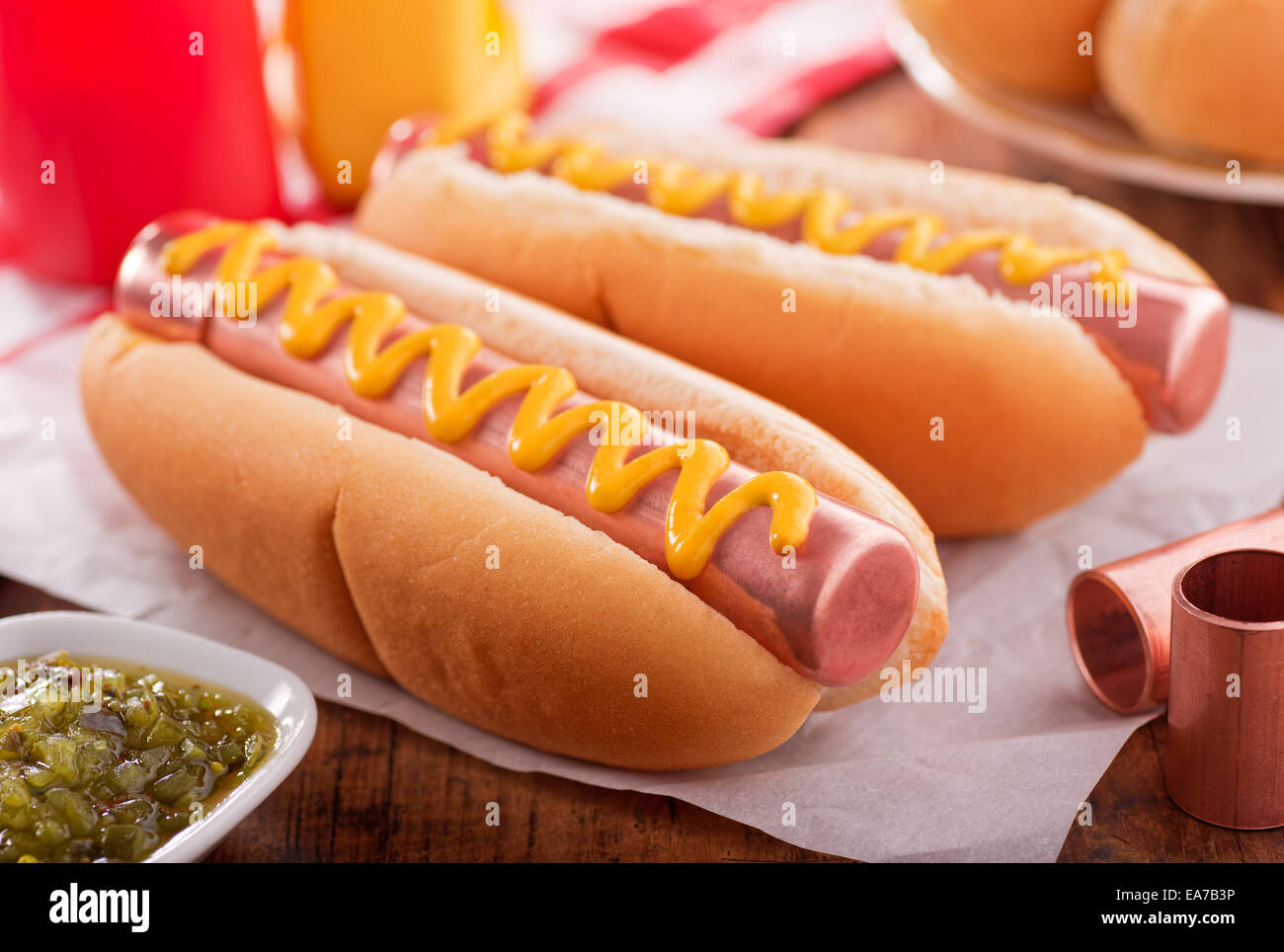 Food humour concept with hot dogs made with copper pipe. - Stock Image