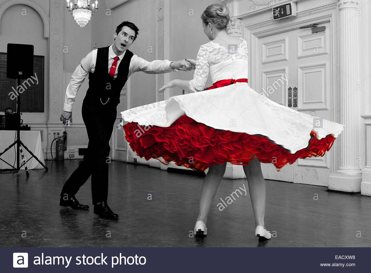 Wedding Couple Swing Dancing Red Petticoat Wedding Dress Stock