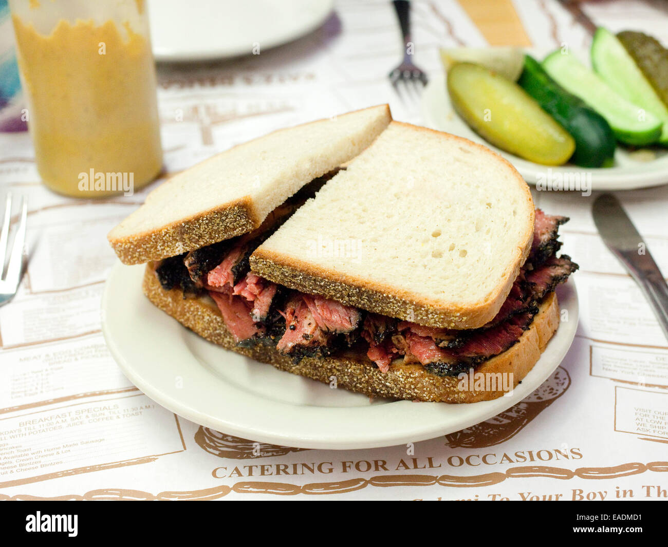 Plated Pastrami on Rye Bread at a restaurant. - Stock Image