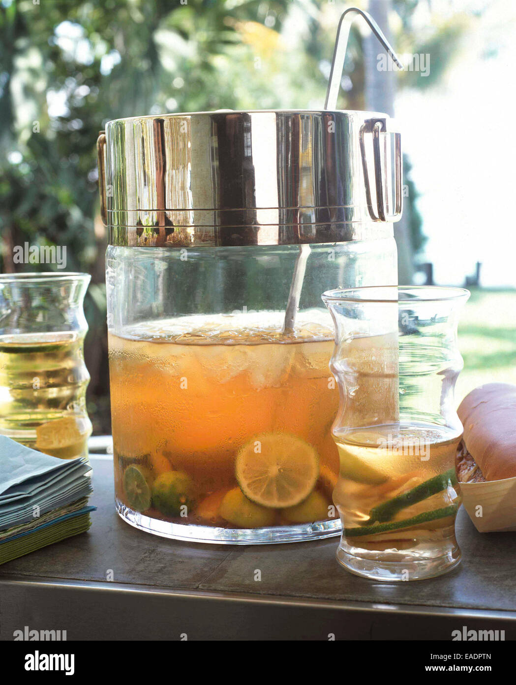 Punch Bowl and Glass in garden - Stock Image